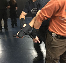 Man in wrist lock using OPN device.