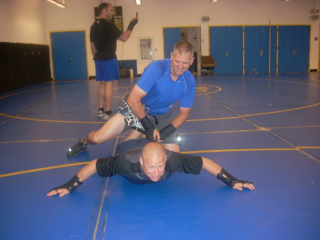 Officer in ankle lock with OPN.