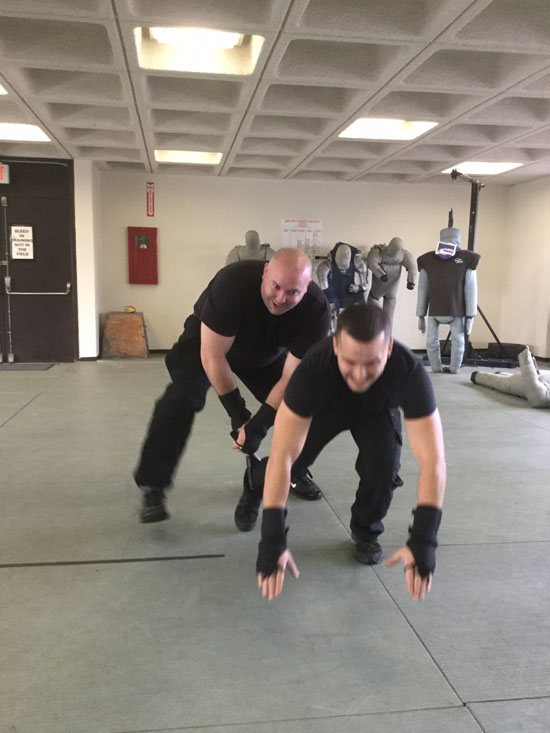Men practicing restraint techniques.