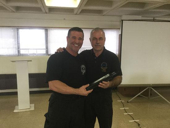 Kevin Orcutt presenting certificate.